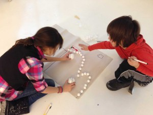 kids create a paper prototype of a game